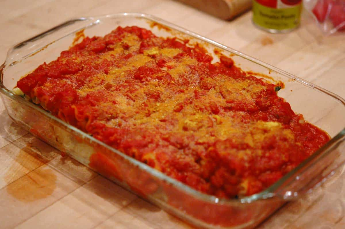 Baked Spinach and mushroom lasagna rolls in a large casserole dish