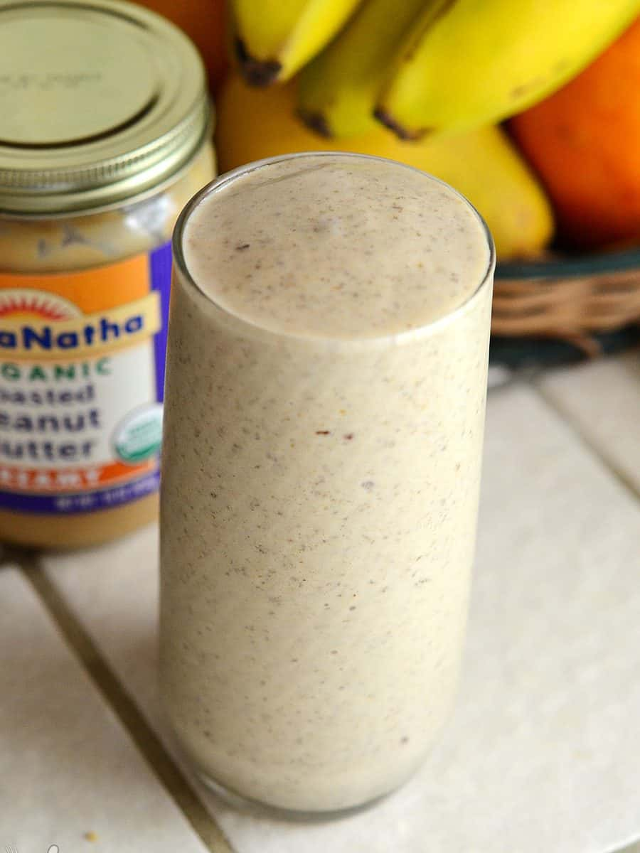 Glass filled to the brim with tan-colored Hangover Cure Smoothie