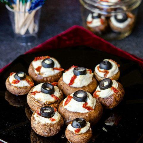 Mmm.. Delicious eyeballs! No, no cannibalism here, just some Stuffed Mushroom Eyeballs, filled with a garlicky tofu ricotta!