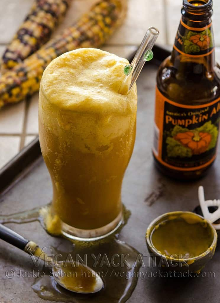 Pumpkin ale in a glass with vegan pumpkin ice cream and pumpkin spice caramel drizzled on top