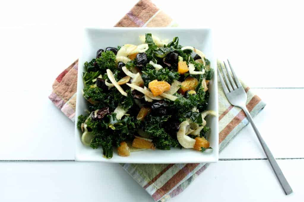 This Winter Kale Salad, is simple, poppin' with flavor and easy to prepare. Perfect for getting a healthy start on your new year!