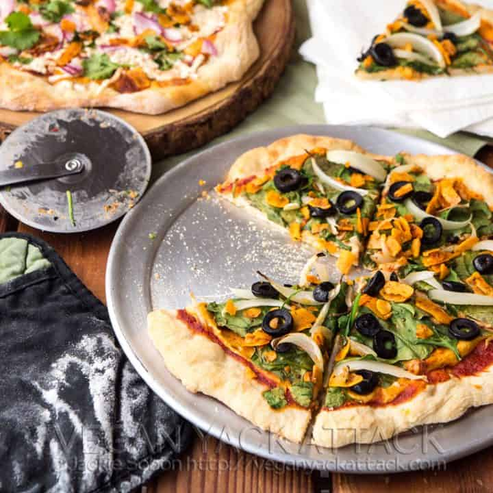Image of two vegan pizzas on a wood table