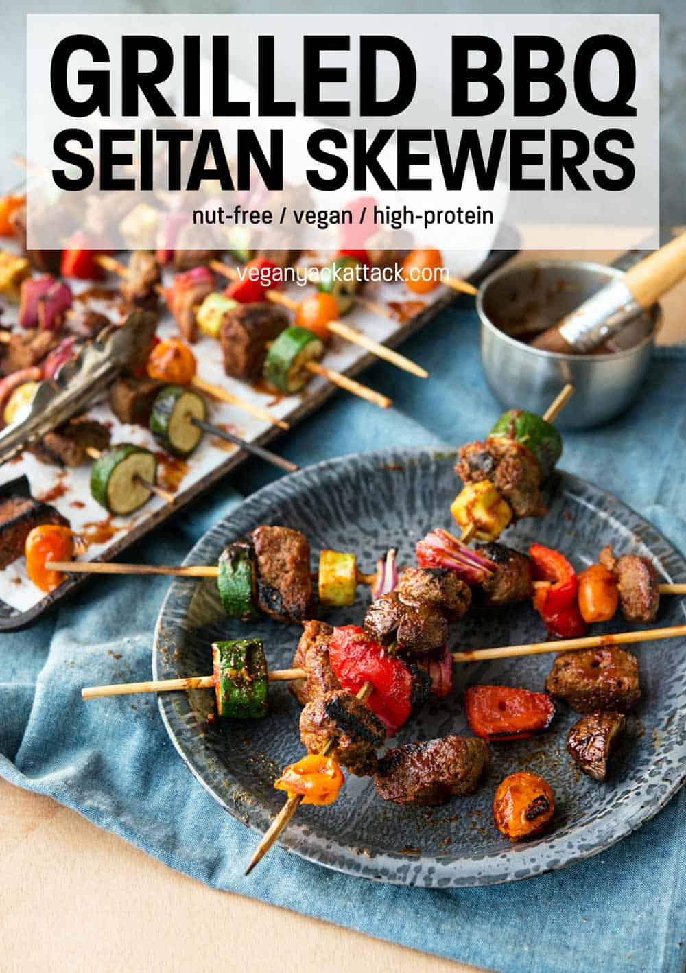 """vegan skewers on a metal plate and denim linen with text reading """"Grilled BBQ Seitan Skewers"""""""