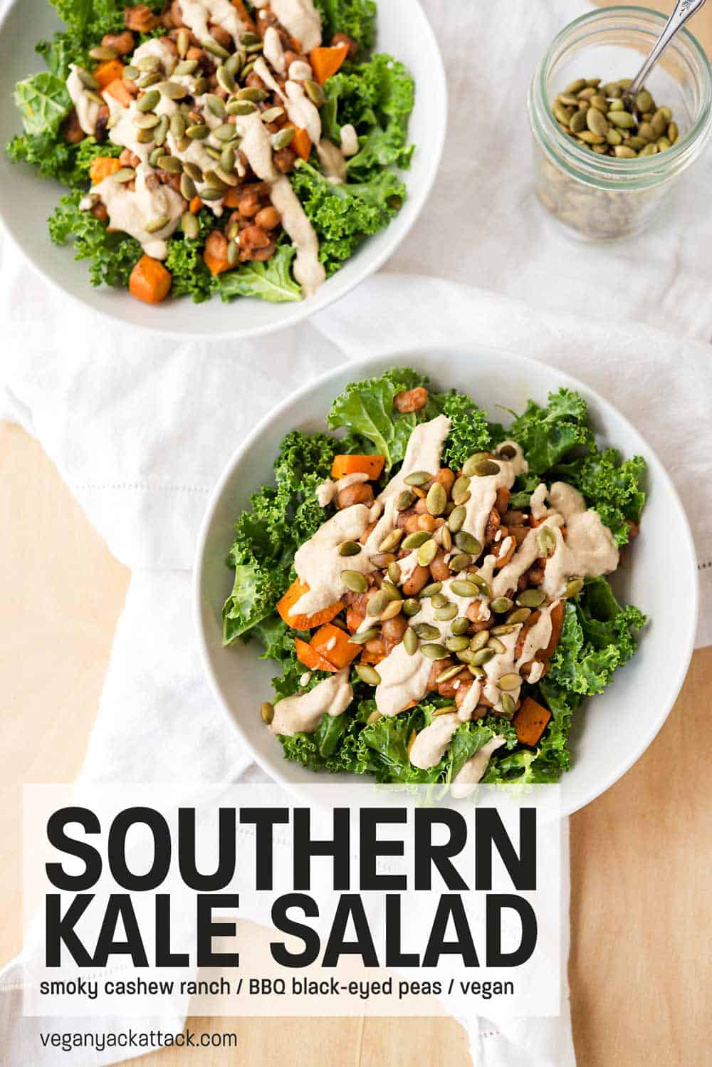 Two bowls of Southern Kale Salad on a white linen and wood table