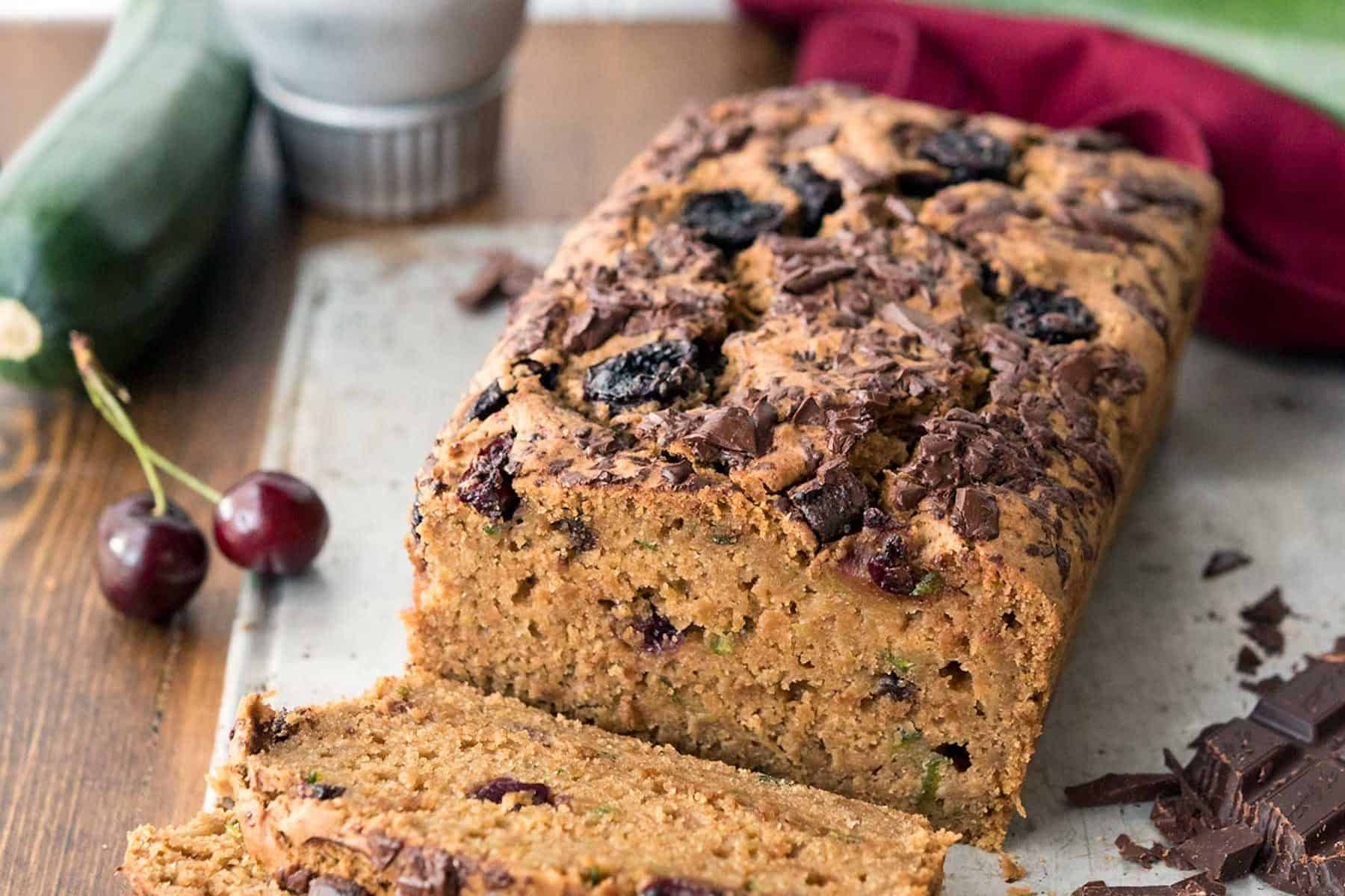 Cherry Chocolate Zucchini Bread! A fantastic way to use some of that summer squash, and make a whole wheat breakfast loaf. Sweetened with coconut sugar! #vegan #soyfree #nutfree #veganyackattack