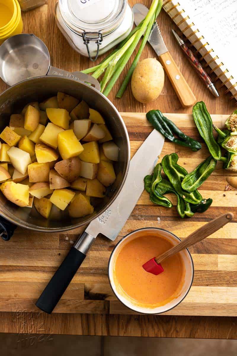 Making spicy sesame potato salad