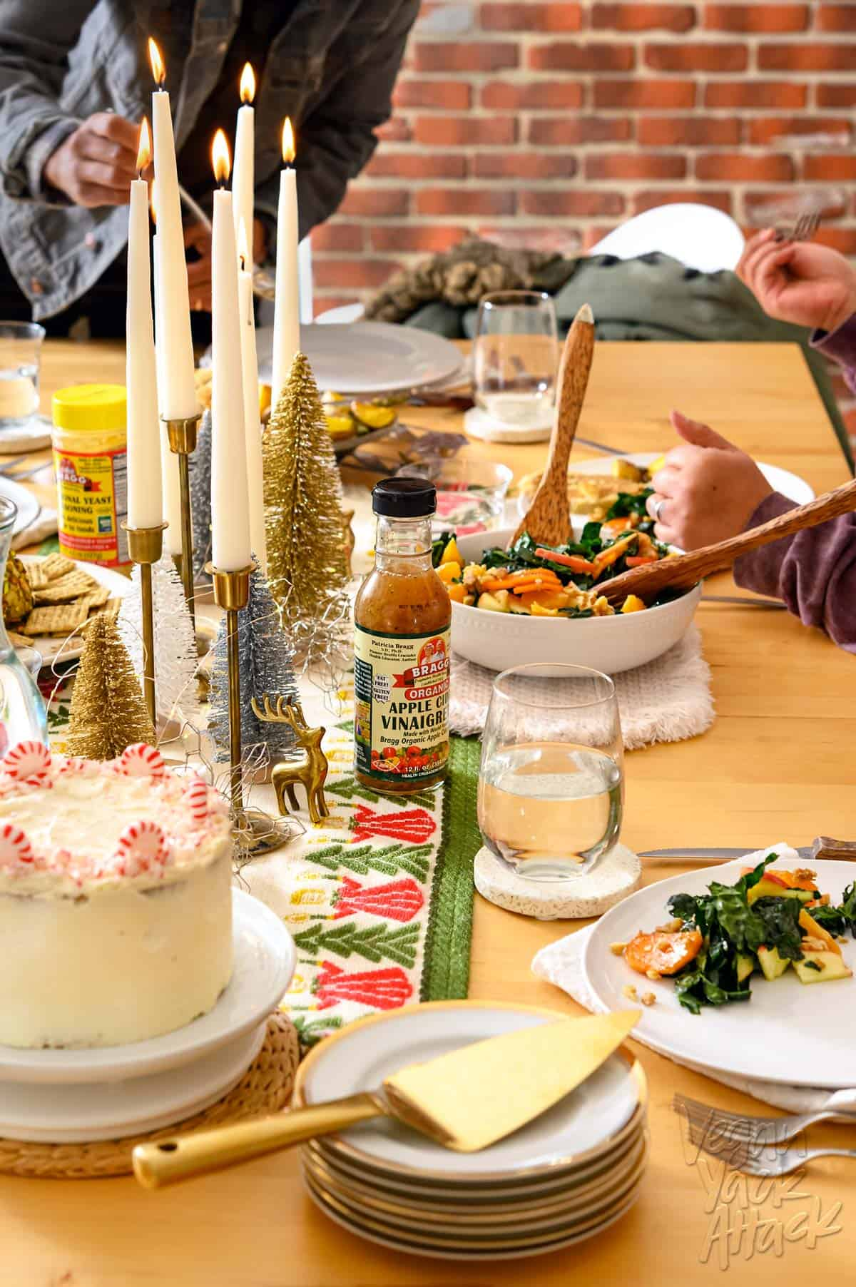 Image of an ultimate vegan holiday dinner spread with table runner and dishes, including salad and cake
