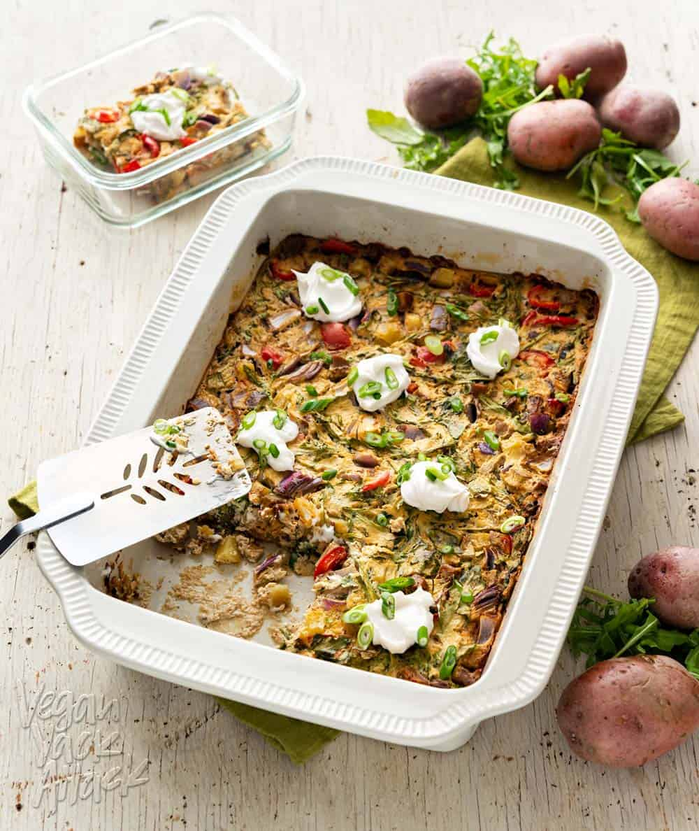 An image of a casserole in a large baking dish, on a wood background with green linen