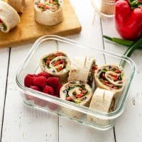 Image of sliced vegan turkey lunch roll-ups in meal prep containers