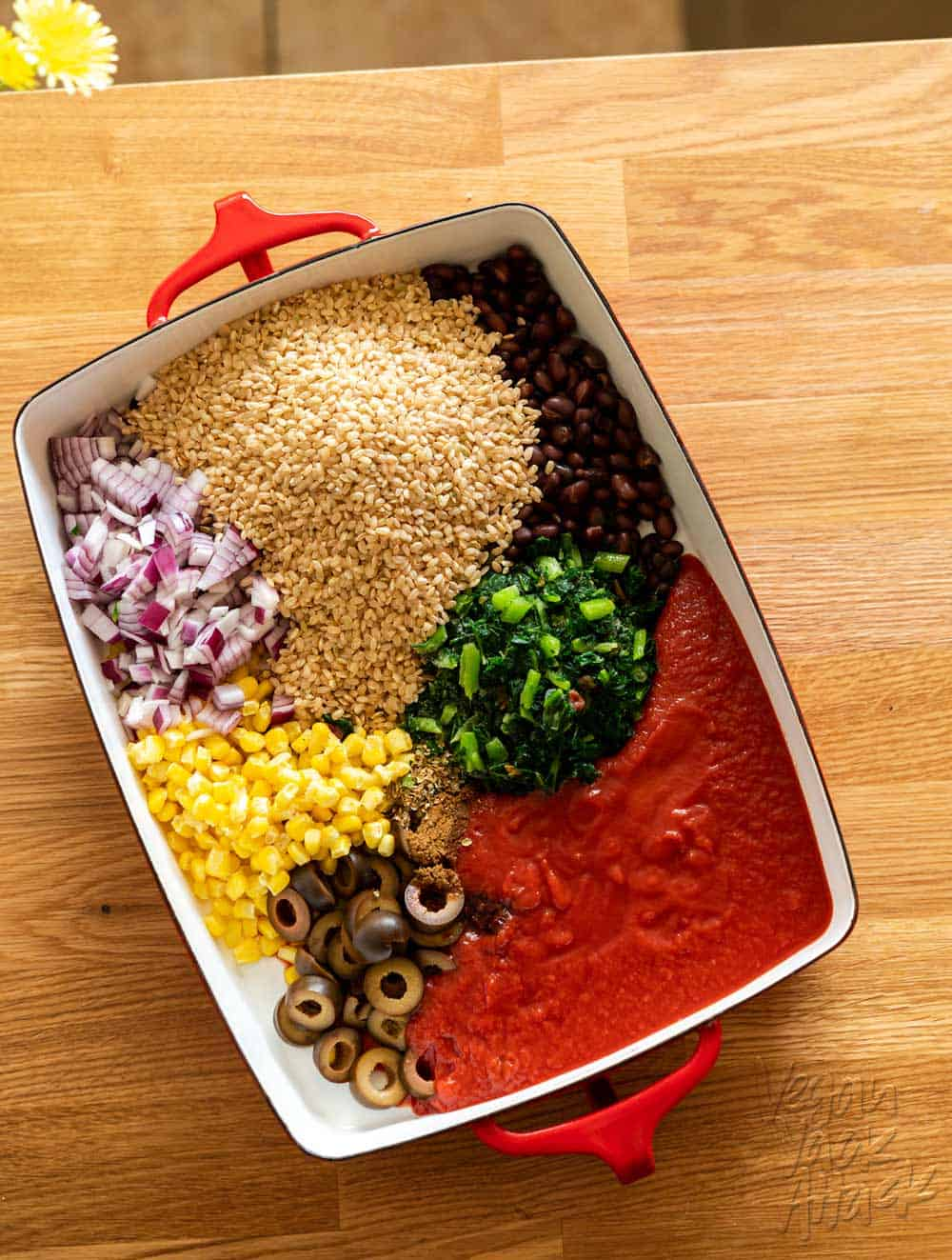 Image of casserole dish with bake ingredients segregated before mixing