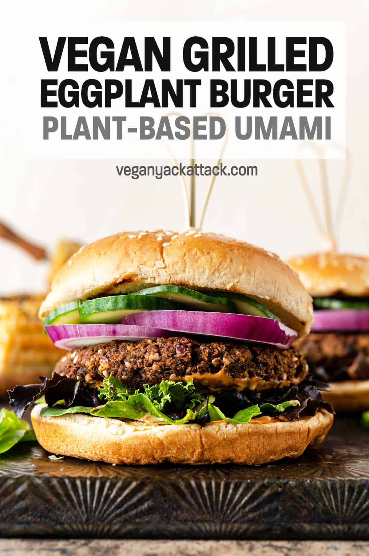 """Close up shot of veggie burger with text reading """"Vegan Grilled Eggplant Burgers"""""""