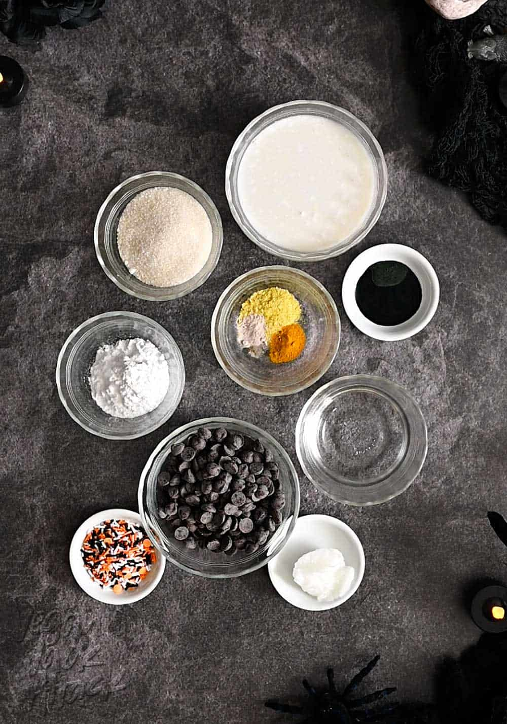 Ingredients for truffles in ramekins on black marble